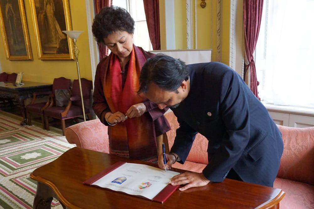 Professor Asha Kanwar and Vijay Krishnarayan sign the MOU